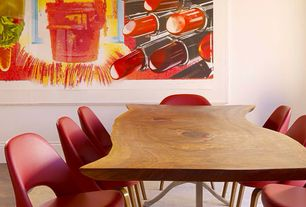 Eclectic Dining Room with Standard height, Hardwood floors, flush light