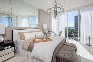 Contemporary Master Bedroom with Standard height, picture window, Concrete floors, Chandelier
