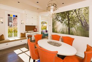 Contemporary Dining Room with Window seat, double-hung window, Hardwood floors, can lights, Standard height, Pendant light