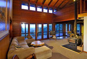 Craftsman Living Room with Built-in bookshelf, Exposed beam, flush light, Carpet, High ceiling