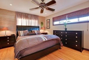 Modern Guest Bedroom with Transom window, Hardwood floors, Ceiling fan