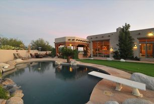 Contemporary Swimming Pool with French doors, Fence, Outdoor kitchen, exterior stone floors, Transom window