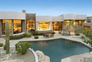 Contemporary Swimming Pool with Glass panel door, exterior tile floors