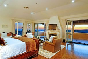 Traditional Guest Bedroom with French doors, Carpet, Laminate floors, Balcony, Cement fireplace