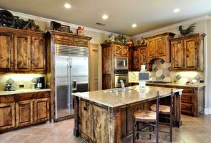 Country Kitchen with Concrete tile , Undermount sink, double wall oven, Framed Partial Panel, built-in microwave, L-shaped