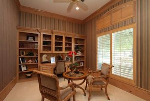 Craftsman Home Office with Ceiling fan, can lights, Built-in bookshelf, Crown molding, picture window, Art desk, Carpet