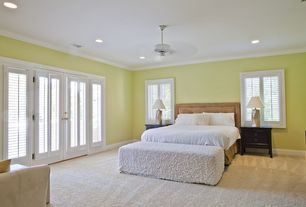 Modern Guest Bedroom with Ceiling fan, Casement, French doors, Crown molding, Standard height, Carpet, can lights