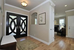 Traditional Entryway with Hardwood floors, flush light, specialty door, Standard height, French doors, Crown molding, Paint