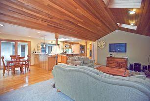 Craftsman Living Room with Hardwood floors, Skylight