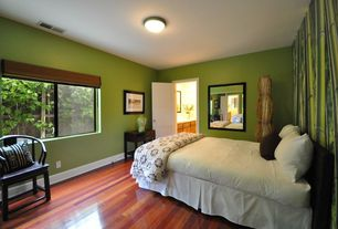 Contemporary Guest Bedroom with flush light, Laminate floors