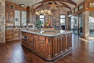 Mediterranean Kitchen with Glass panel, Exposed beam, L-shaped, Simple granite counters, avignon 5 piece custom cabinets