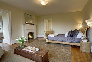 Eclectic Master Bedroom with Hardwood floors, flush light, Cement fireplace, Wall sconce