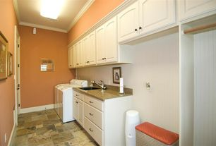 Traditional Laundry Room with Undermount sink, Built-in bookshelf, Crown molding, Standard height, stone tile floors