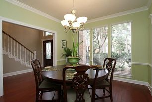 Traditional Dining Room with Chair rail, Pendant light, Bamboo floors, Crown molding