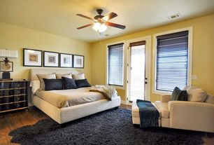 Contemporary Guest Bedroom with Crate & Barrel Axis II Chair, Ceiling fan, French doors, Hardwood floors, flush light