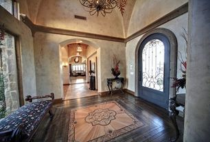 Mediterranean Entryway with Glass panel door, Maxim Lighting Manor 9-Light Chandelier  (, Crown molding, Chandelier