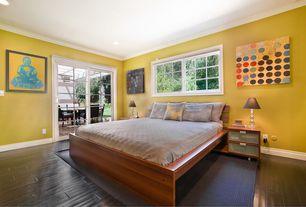Contemporary Guest Bedroom with Hardwood floors, Glass panel door, Mural, Crown molding, Carpet