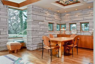 Modern Dining Room with Standard height, Carpet, Built-in bookshelf, specialty window, picture window, can lights