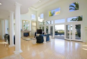 Modern Living Room with Carpet, Transom window, Laminate floors, Fireplace, Columns, picture window, brick fireplace