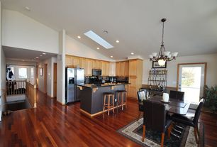 Craftsman Kitchen with French doors, L-shaped, Soapstone counters, Hardwood floors, Kitchen island, Chandelier, Skylight
