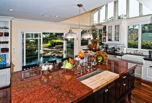 Traditional Kitchen with Built-in bookshelf, Farmhouse sink, sliding glass door, Crown molding, One-wall, High ceiling