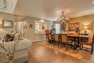 Traditional Dining Room with can lights, Standard height, specialty window, picture window, Brick floors, Chandelier