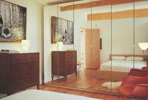 Modern Master Bedroom with Exposed beam, Hardwood floors, Ikea tejn faux sheepskin - white