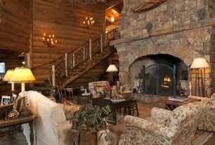 Rustic Living Room with Natural wood railing, Neutral area rug, Chandelier, Natural wood stair treads, Upholstered armchair