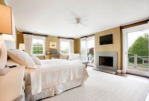 Contemporary Master Bedroom with interior wallpaper, Built-in bookshelf, French doors, Cement fireplace, Hardwood floors
