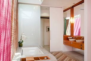 Contemporary Master Bathroom with Master bathroom, Concrete floors, European Cabinets, Double sink, Vessel sink, Flush