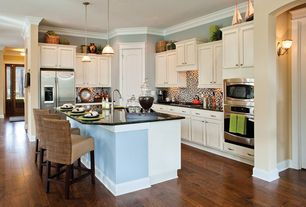 Traditional Kitchen with Crown molding, Built In Refrigerator, wall oven, Ceramic Tile, Hardwood floors, Pendant light