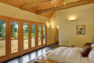 Craftsman Master Bedroom with French doors, flush light, Exposed beam, Concrete floors, Wall sconce