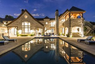 Rustic Swimming Pool with Lap pool, Pathway, Deck Railing, Casement, exterior stone floors, French doors, Covered deck