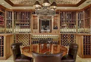 Mediterranean Wine Cellar with Chandelier, slate floors, Wine storage, Built-in bookshelf
