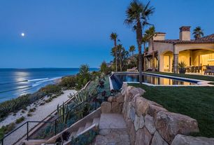 Tropical Landscape/Yard with exterior stone floors, Ocean view, Covered porch, Palm trees, Infinity pool