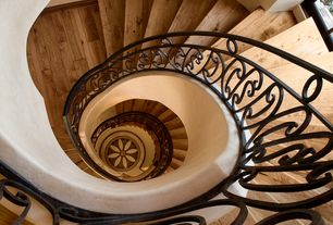 Mediterranean Staircase with Spiral staircase, High ceiling, Hardwood floors
