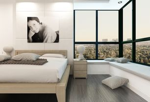 Modern Master Bedroom with Laminate floors, Foscarini rituals 3 table lamp, Window seat, Cb2 concrete nightstand