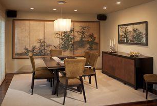 Asian Dining Room with Hardwood floors, Artemide Lighting Logico Triple Linear Suspension Light, Built-in bookshelf