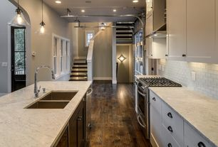 Contemporary Kitchen with full backsplash, European Cabinets, Kitchen island, Subway Tile, can lights, dishwasher, Flush