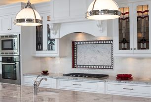 Traditional Kitchen with Glass panel, Subway Tile, One-wall, Pendant light, European Cabinets, Complex marble counters