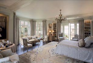 Traditional Master Bedroom with Casement, Crown molding, Built-in bookshelf, Hardwood floors, Exposed beam, Standard height