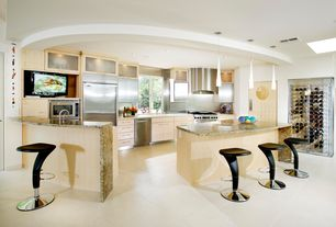 Modern Kitchen with Simple granite counters, High ceiling, Kitchen island, Breakfast bar, specialty door, Pendant light