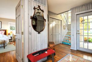 Cottage Entryway with French doors, Hardwood floors