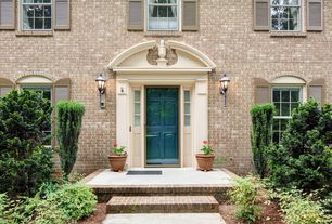 Traditional Front Door with double-hung window, exterior brick floors, six panel door, Pathway
