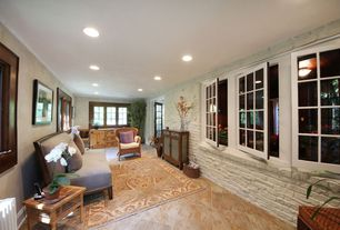 Eclectic Living Room with Crown molding, French doors, travertine tile floors