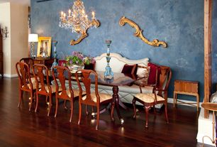 Eclectic Dining Room with Chandelier, Armstrong Flooring- Oak - Cherry, Hardwood floors, Wall sconce, Columns