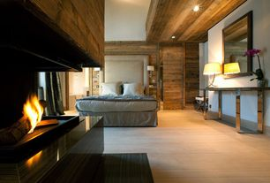 Contemporary Master Bedroom with Hardwood floors, Columns, High ceiling