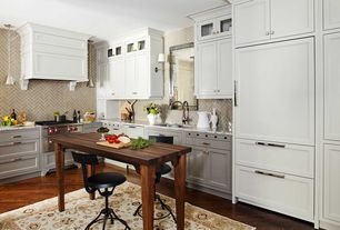 Contemporary Kitchen with electric cooktop, Wall Hood, gas range, Complex marble counters, Kitchen island, Paint, Wall sconce