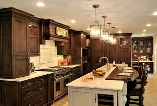 Traditional Kitchen with Pendant light, Glass panel, Flat panel cabinets, Custom hood, Oregon Tile & Marble Calacatta Marble