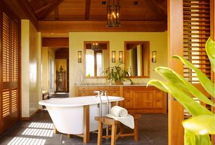Master Bathroom with Flat panel cabinets, Pendant light, Louvered door, Wall sconce, Double sink, Freestanding